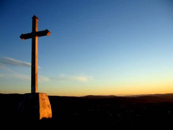 cross and setting sun